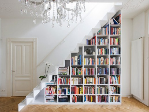Contemporary-staircase-with-minimalist-book-shelves-in-all-white